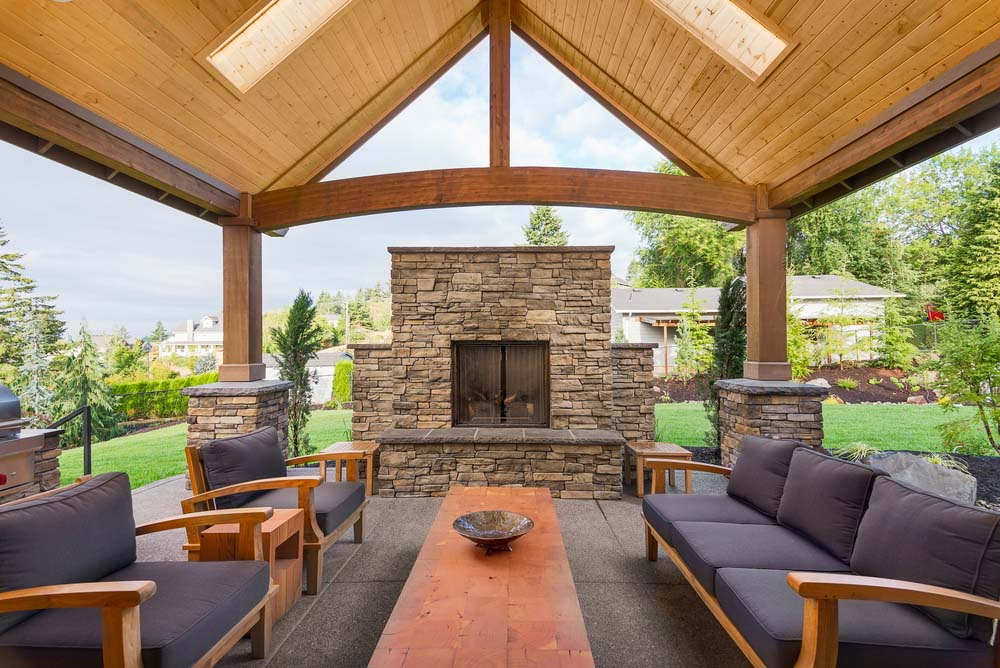 Genial Stone Screened Fireplace Beneath Arched Wood Patio