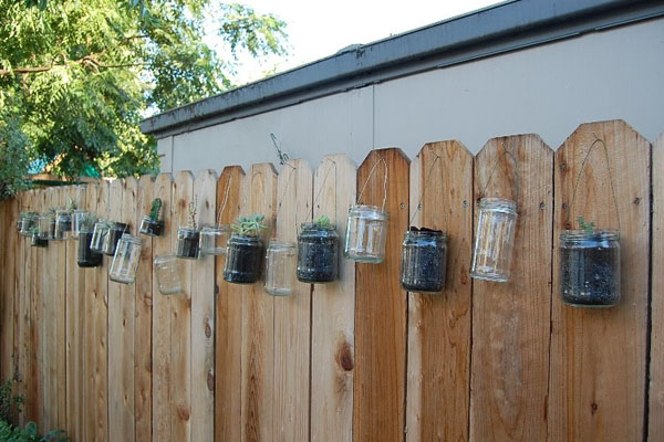 15 fence planters that ll have you loving your privacy fence again