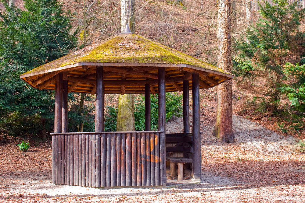 We've seen a couple rustic-styled gazebos already, but this model takes the cake. It's got a true log-cabin construction with natural log beams supporting a richly layered wood roof, sprinkled with moss on top. A structure like this could have been built any time in the past 300 years, and its timeless style is paired with a timeless usefulness. Built-in bench seats and a thick low wall add comfort and protection from the elements.