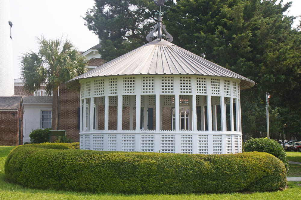 While the general shape of all gazebos is roughly circular, they most often appear in the shape of an octagon or hexagon. This unique model is comprised of enough smaller sections to become a de facto circle, with a conical, highly textured roof overhead adding a dose of contrast. The lattice design of the framing makes for an open and inviting appearance.