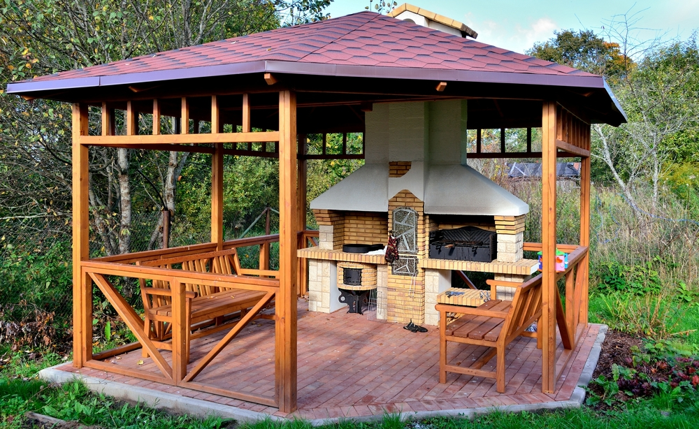 This might be our favorite gazebo yet. It's not only a handsome natural wood design with a subtle red roof and matching red brick foundation. This large gazebo features a large hearth and grilling station, perfect for outdoor family gatherings and cooking out. The large roof and twin bench seats provide plenty of shelter and comfort, while the large brick oven provides all the warmth and cooking possibilities you could ask for.