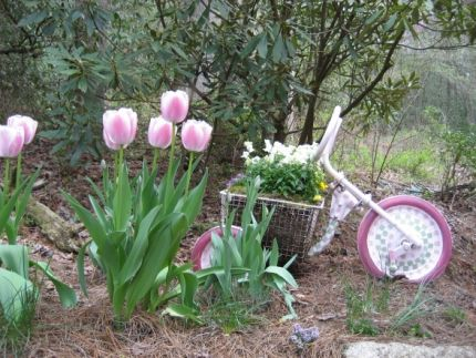 This fantastic creation was made from an old discarded tricycle that was repainted with an eye-catching pink and white color scheme, supporting a wireframe gym locker basket. The basket means plenty of room for your plants and soil, and the bright colors and fun shape make it an attractive addition anywhere in your garden. Pair it with similarly colored flowers for a style bonus.