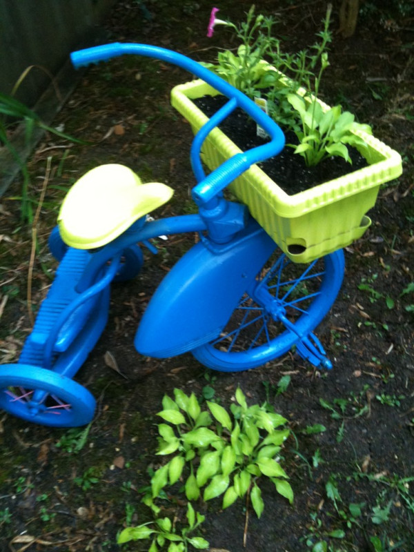 Similar to the pink project we showcased above, this bold, bright, and blue model features a nice hand painted coating across the entire frame and wheels for a uniform, attractive look. This one was paired with a bright green seat and matching green basket, completing a handsome, color-coordinated look. If you're aiming for a project like this, you can start with the cheapest of old tricycles, because it won't matter what it looks like before you get to it.