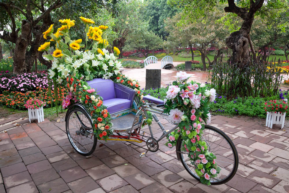 This might not be something just anyone has lying around the house, but a rickshaw-style tricycle can make an amazing portable container garden. The example pictured is strung with roses and other flowers from top to bottom, making for a striking appearance that probably took quite a bit of work to nail down. The point is, if you've got access to something like this, it's a perfect opportunity to get creative and see where you land.