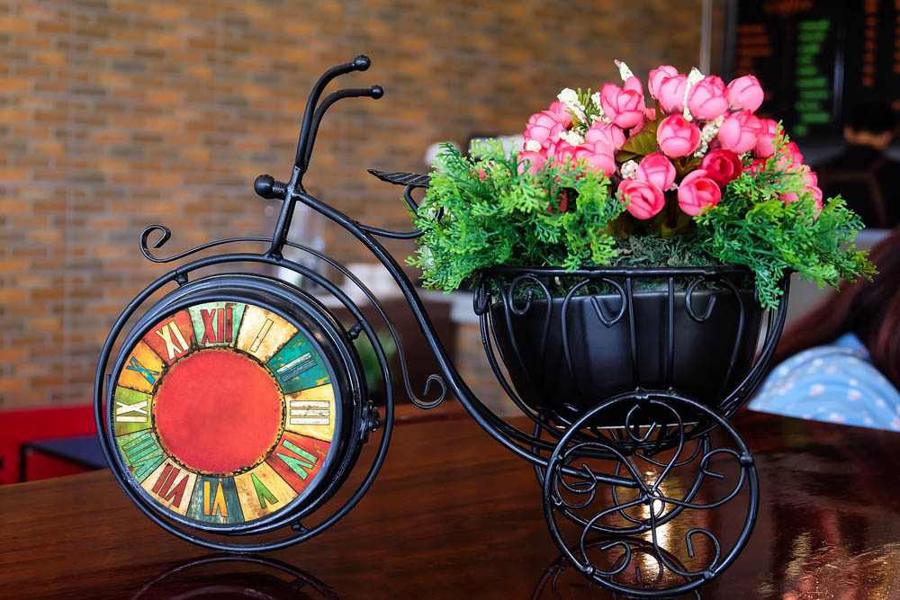 This gorgeous tabletop container garden is a fine piece of handcrafted metal in the shape of an old fashioned tricycle, but it's clearly not going anywhere fast. The small size means that, while nobody is going for a ride, it's able to add a dose of flowery beauty to any horizontal surface in your home. We love the idea of setting this handsome planter up on a hallway table, a countertop, or even at the center of a large dining room table.