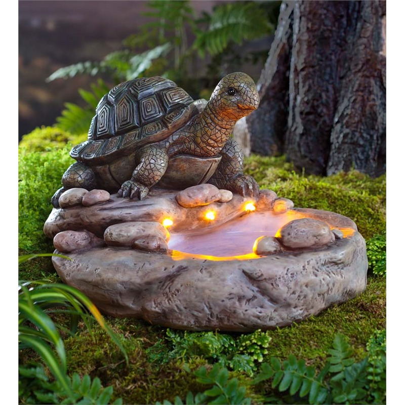 Our first garden decoration is a somewhat complex piece, featuring a tortoise sculpture over a rock bed stand, with a small bowl for water at the center. The most striking feature is the set of embedded lights, making for a beautiful little glowing, watery element when placed in your garden.