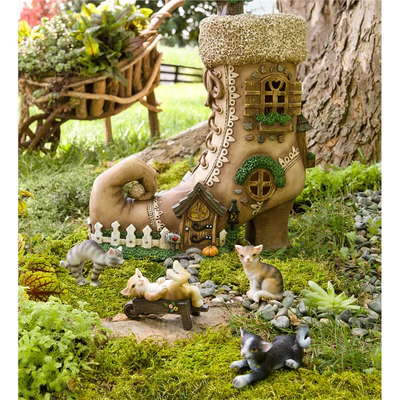 Speaking of whimsy, you can't get much more fantastical than this handsomely carved little boot house, wrapped with intricately detailed windows and doors. A set of tiny kitten sculptures comes with the boot, letting you set up a de facto fairy garden in minutes.
