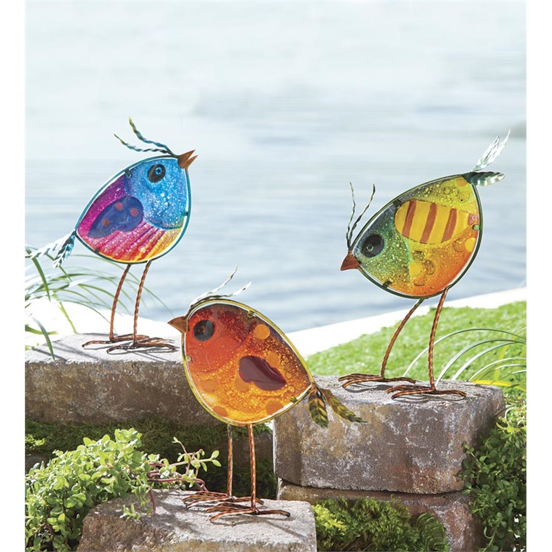 This is one of our favorite items on the list, an absolute rush of color and light that we think would look delightful in any outdoor setting. The multicolored glass has an appeal all its own, only improving with its setting inside an abstract bird sculpture. Set a few of these in the grass on the edges of your garden, plant them amongst the vegetables, or set them up on fence posts for an evocative look.