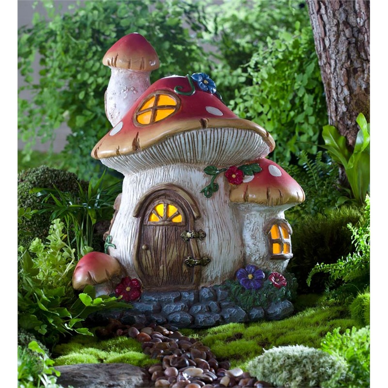 Mushrooms have a distinct look that's beloved for its pliability; they can seem fun and cartoonish, realistic and natural, and happen to make some of the best frameworks for a fairy garden. This piece boasts the addition of interior lighting, making for a warmly glowing presence in your garden at night time.