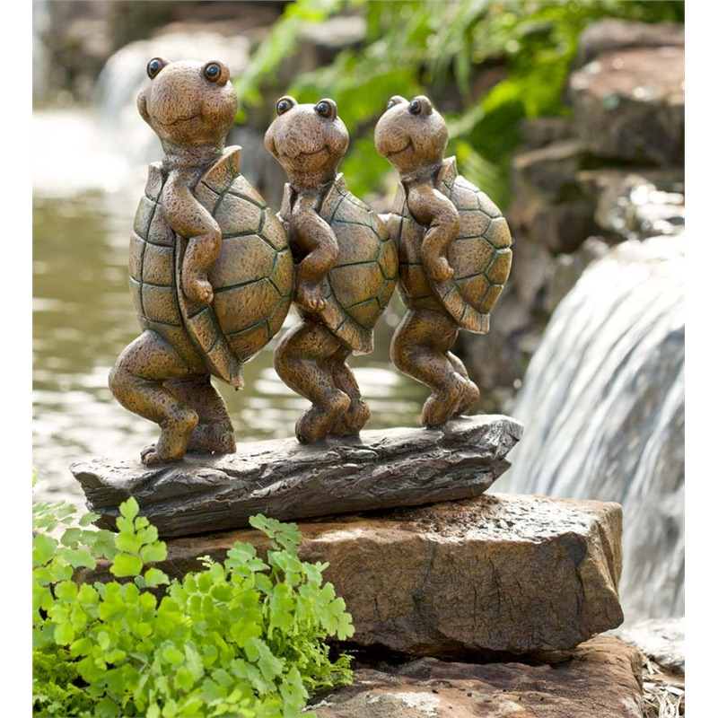 So we've seen other sets of anthropomorphized tortoises in various poses, but this has got to be the most childlike and whimsical of all. The three reptiles are doing some sort of line dance on a log, and we can't help but imagine the delight on children's faces as they behold this adorable sculpture. If you've got children of your own, or ones that visit often, your garden will be a source of delight for years to come.