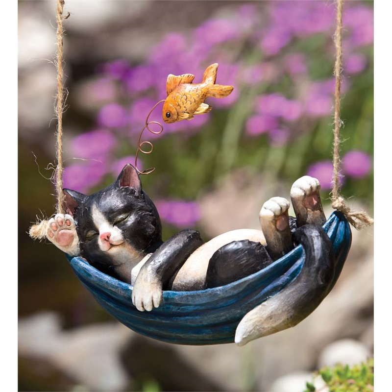 We saved one of our favorites for last. This ultra-whimsical piece features a cat slumbering in a hammock, dreaming of goldfish. It's surreal, colorful, and perfectly shaped to hang above or in your garden. If you've got a tree or fence nearby, you're perfectly equipped to hang this accessory over your landscape.